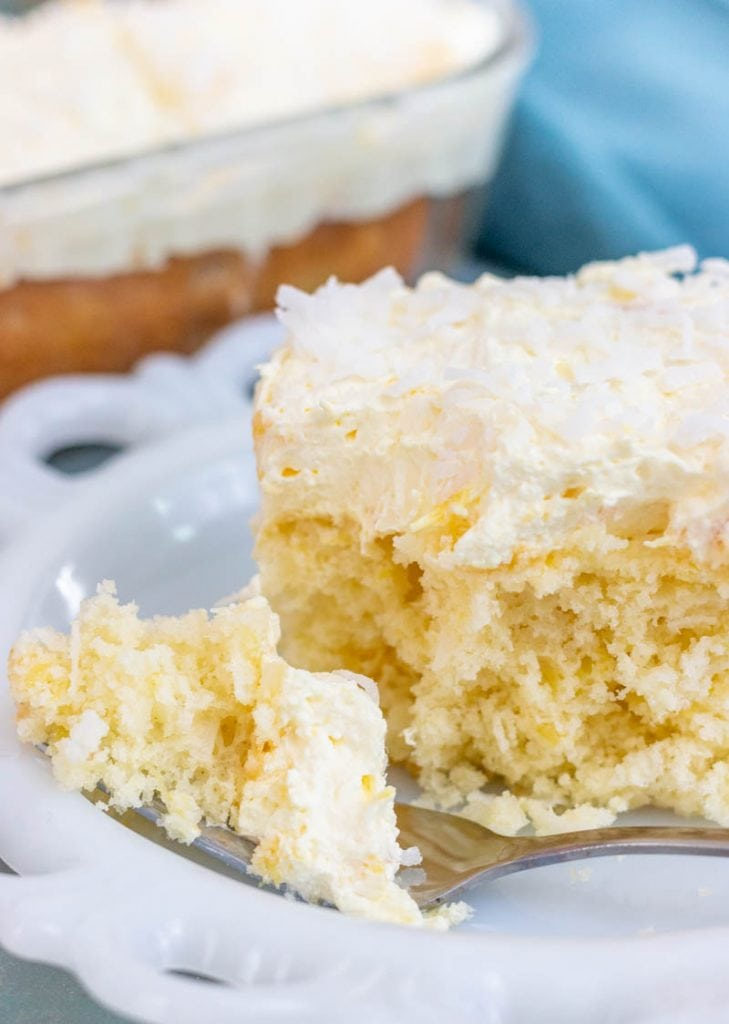 Slice of pineapple coconut cake with a fork