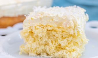 Pina Colada Cake Bar Slice on white plate