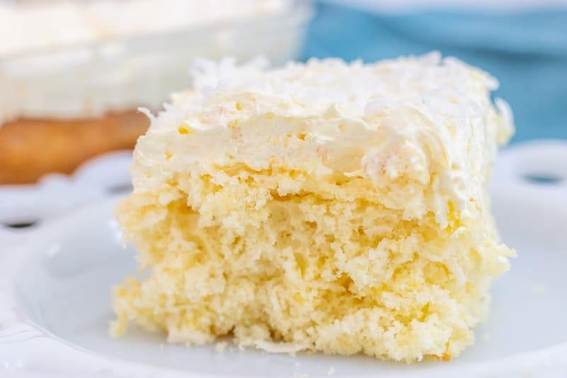 Pina Colada Cake Bar Slice on white plate