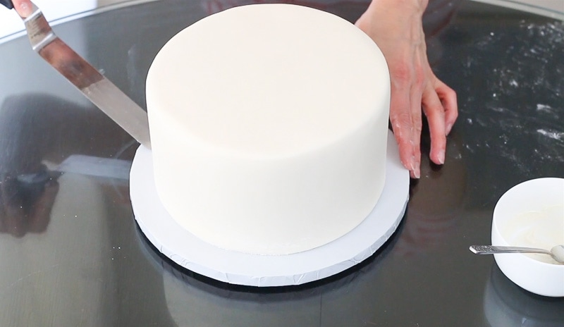 Place cake on cake board