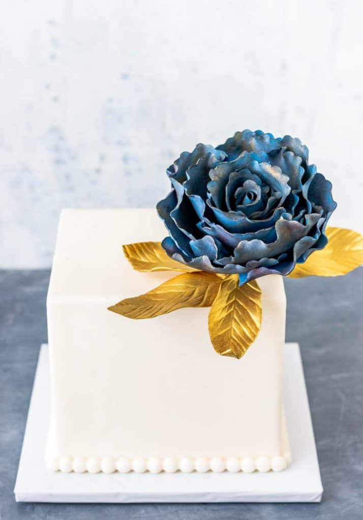 Ruffled Rose Gumpaste Fantasy Flower on square cake