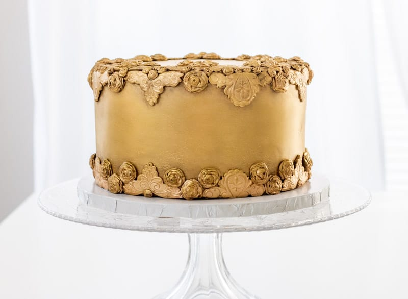 Antiqued Bas Relief Cake on cake stand