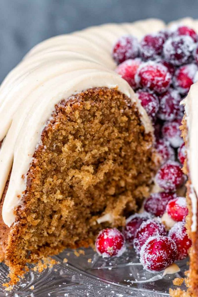 Sliced brown sugar spice cake with cranberries