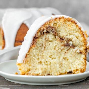 Slice of cinnamon swirl sour cream cake on a white plate