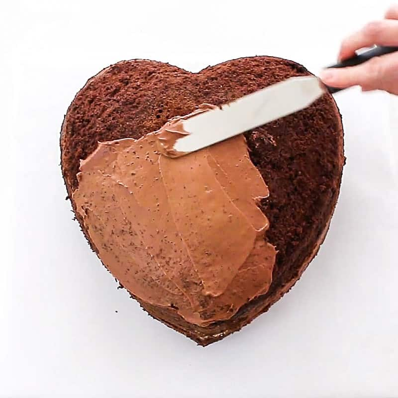 crumb coating the heart cake