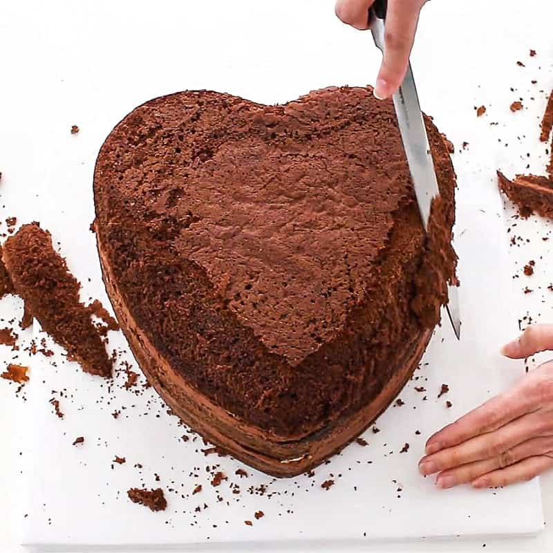 carving the puffed heart cake