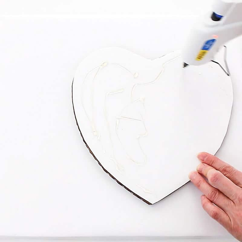 attach the heart cake board to the cake base