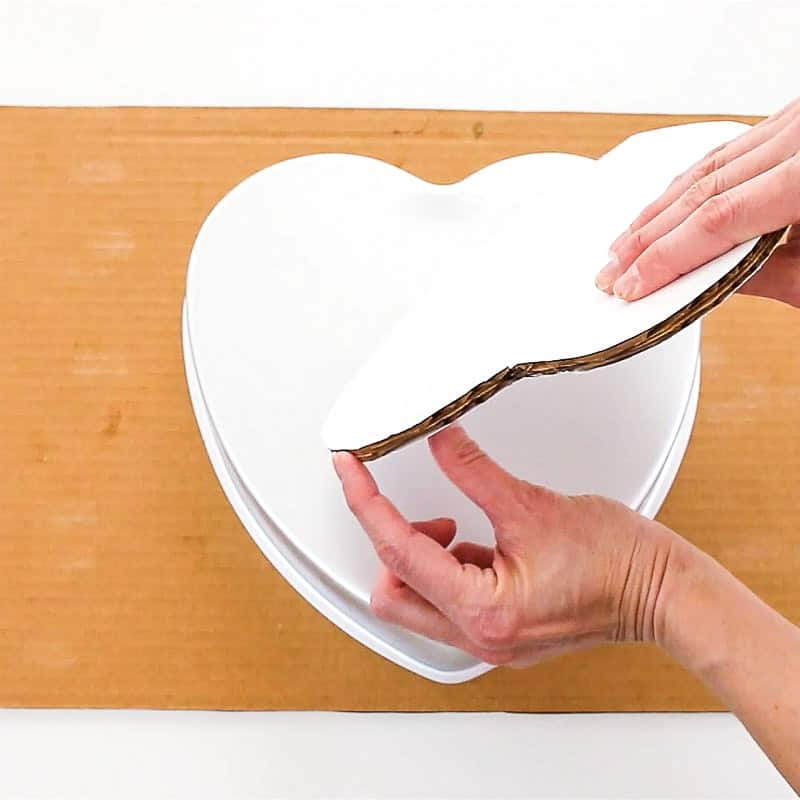 Glue two heart cake boards together