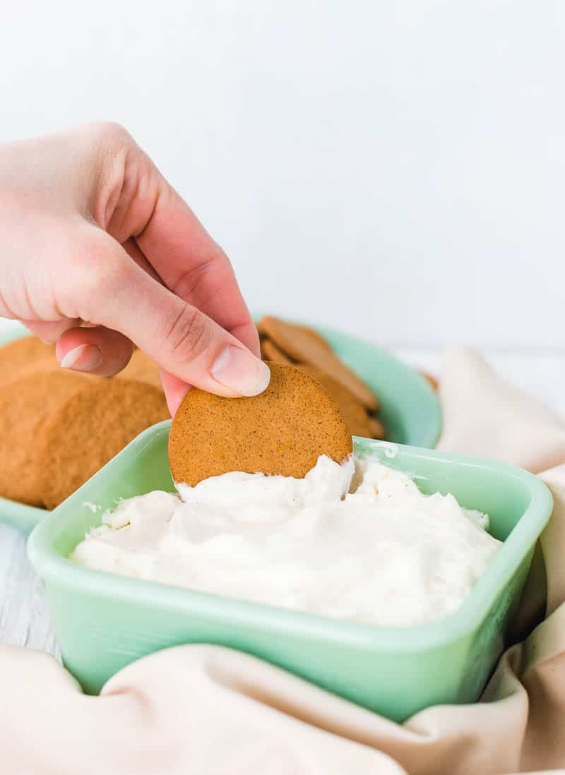 dipping cookie into dessert dip