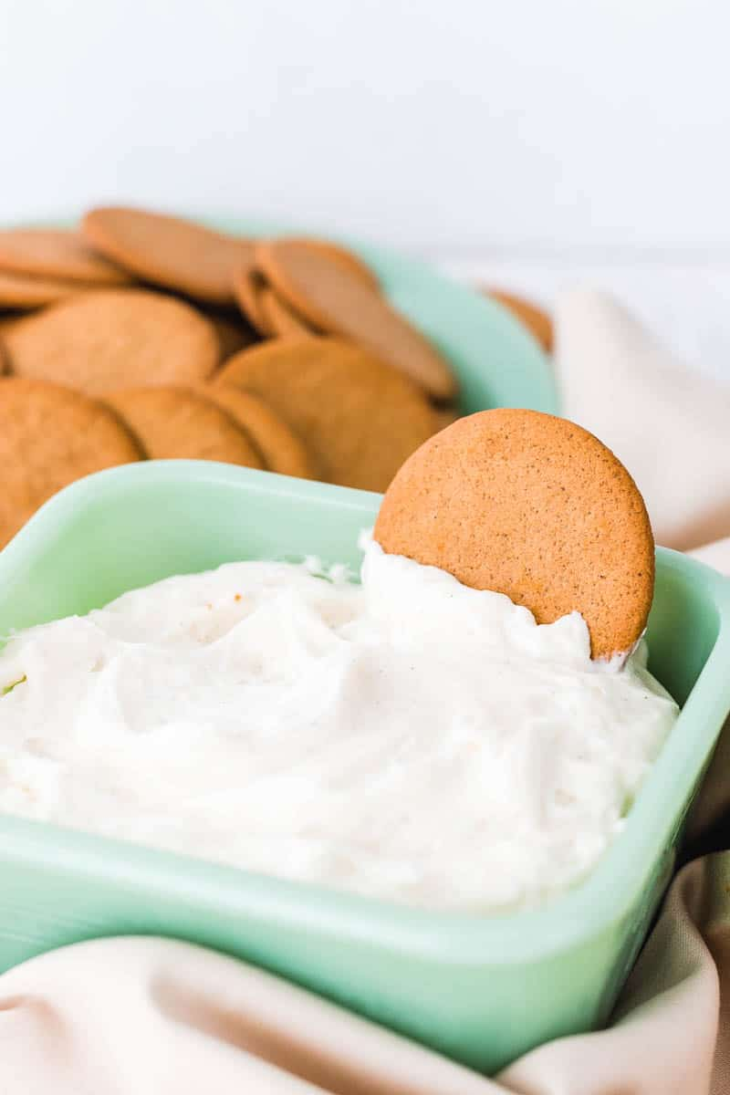 bowl of cream cheese dip with cookie