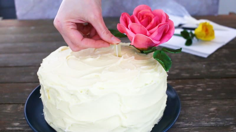 inserting straw into cake for gumpaste flowers