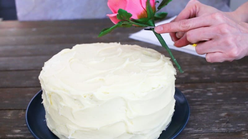 insert the gumpaste flowers into the cake