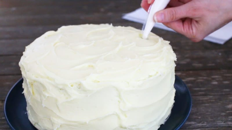 adding melted candy melts to straw in cake