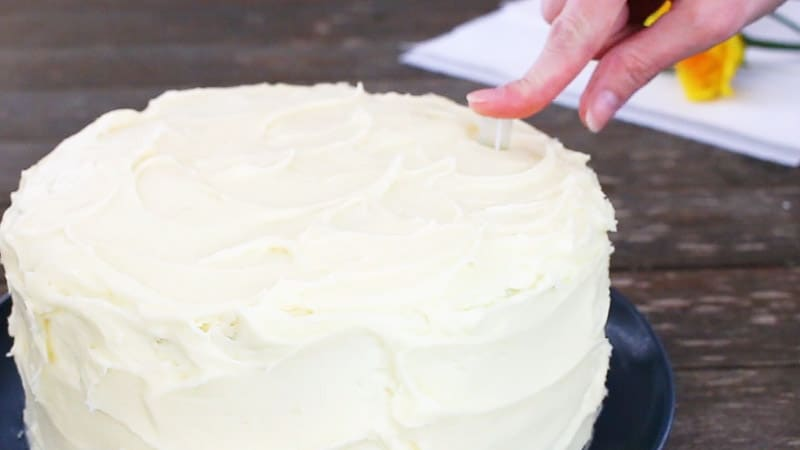 inserting a straw into cake for the gumpaste flower
