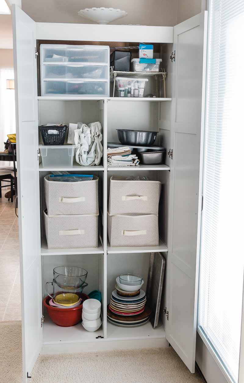 Pretty and Functional Ways to organize baking supplies free standing cabinet
