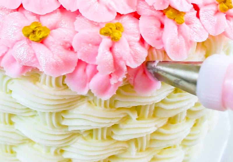 pipe random petals on the cake