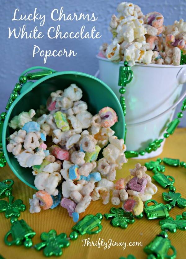 lucky charms white chocolate popcorn in a green pail