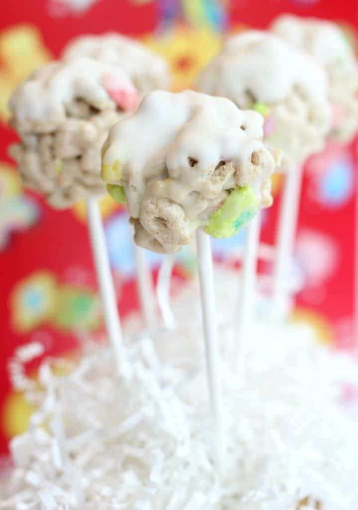 Lucky Charms White Chocolate Cereal Pops in front of a red cereal box