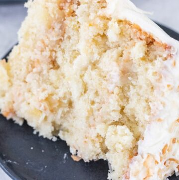 Pineapple Coconut Cake with Pineapple Filling Sliced on a plate
