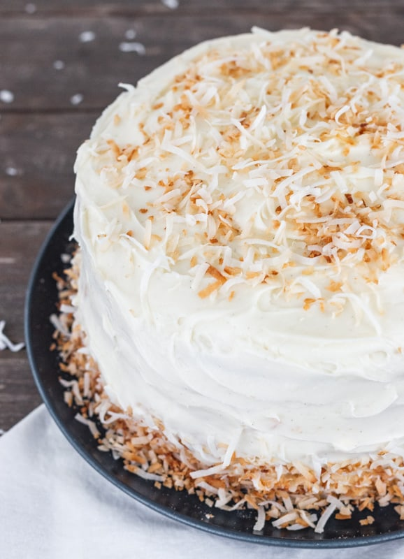 Toasted coconut on top of coconut cake