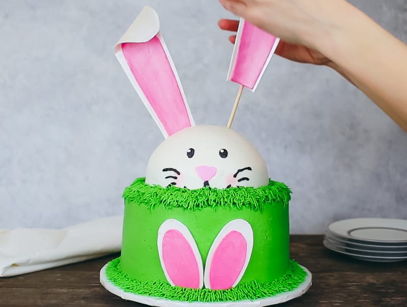 adding gumpaste bunny ears to cake