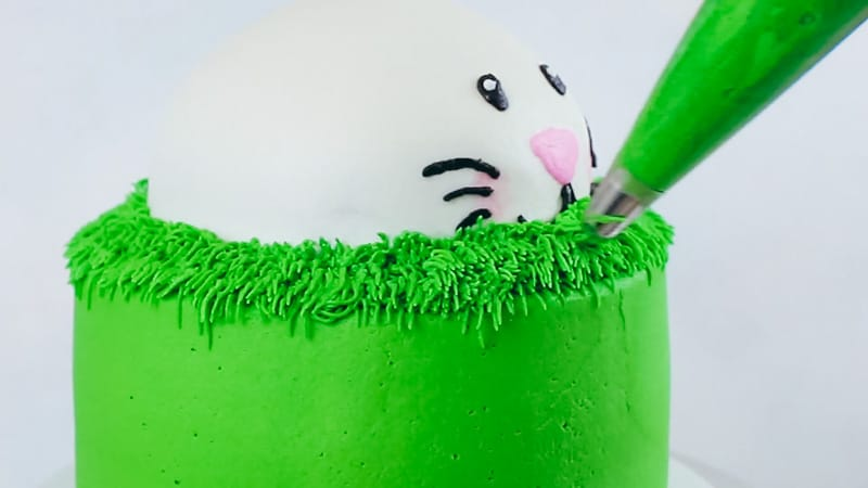 piping buttercream grass on bunny cake