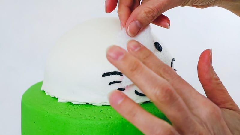 smoothing the bunny's eyes on bunny cake