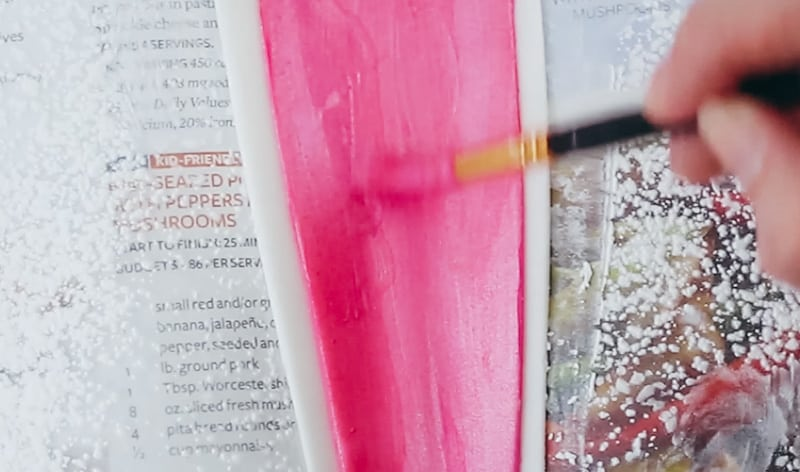 painting pink luster dust onto the gumpaste bunny ears