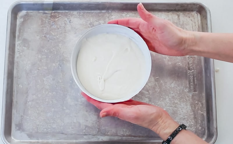 pouring cake batter into sphere pan