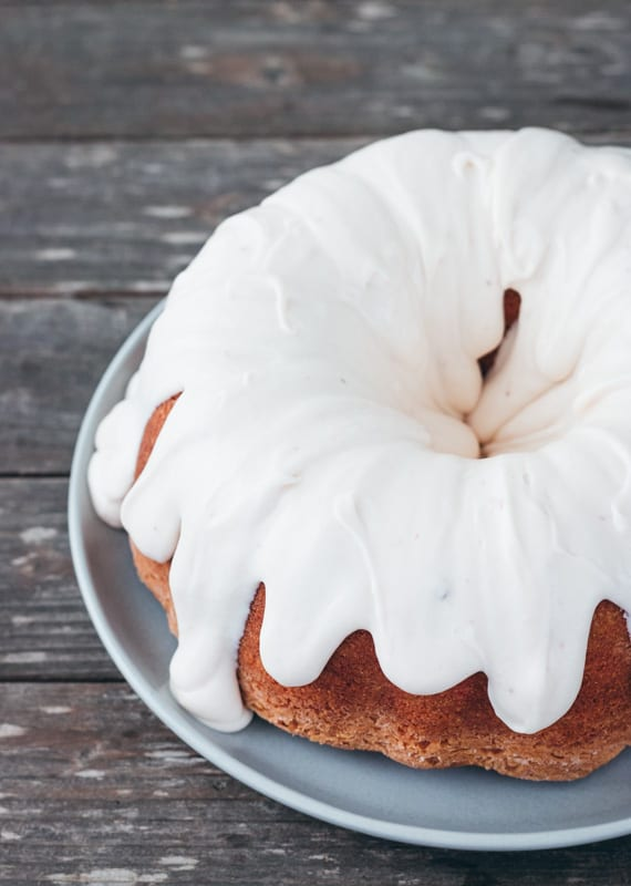 Strawberry Bundt cake with glaze on a wood table