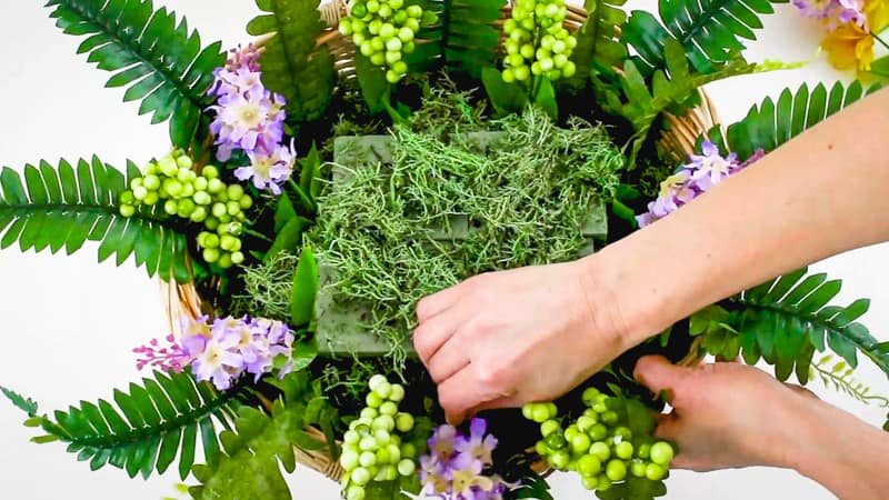 add in larger flowers and berries to your basket