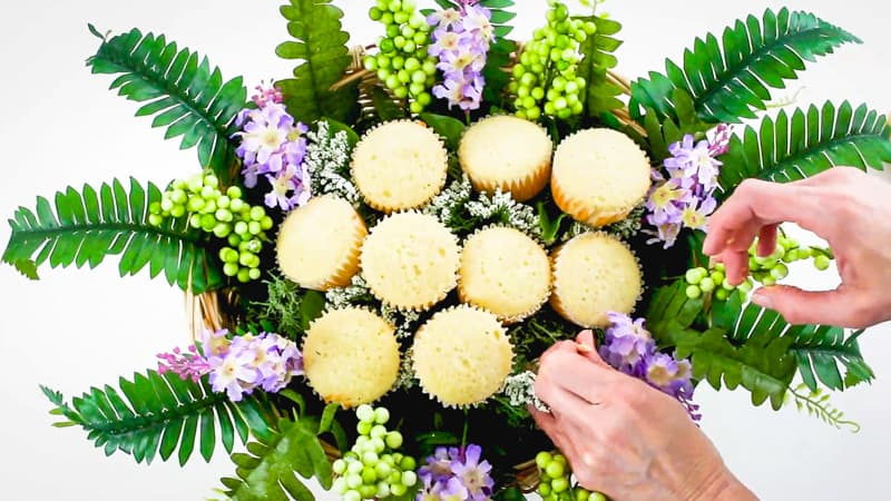 adjust the flowers in the cupcake bouquet basket