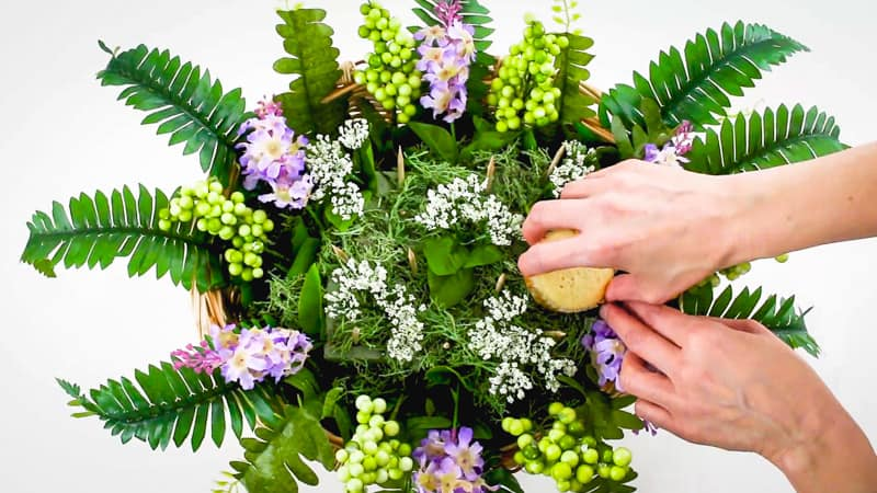 inserting cupcakes into cupcake bouquet