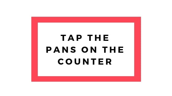 tap the pans on the counter graphic