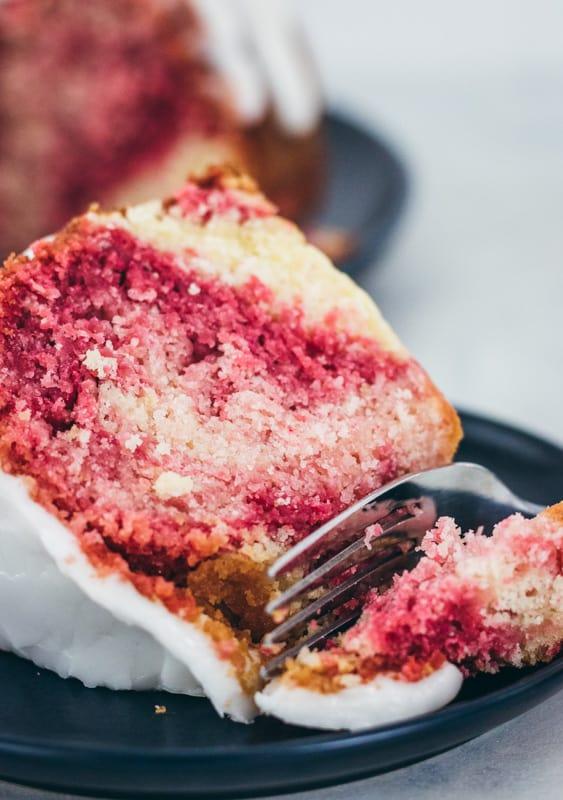 slice of lemon raspberry cake with a fork