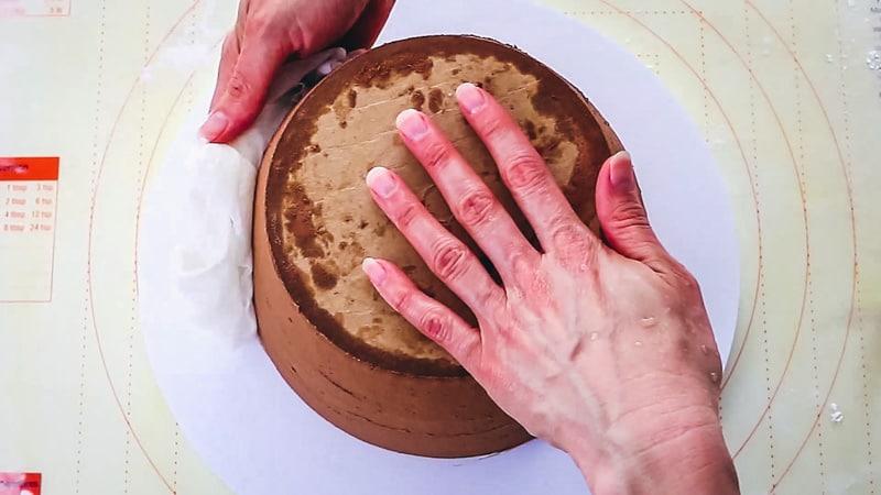 moisten cake to add fondant