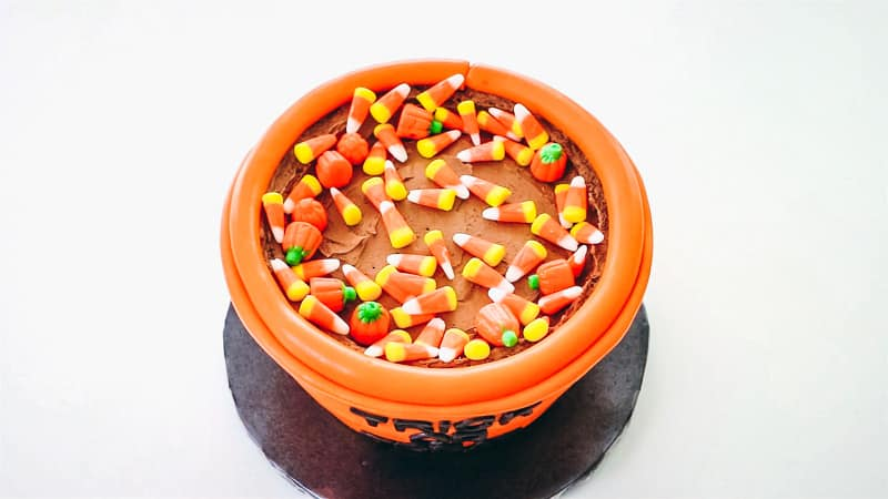 adding candy corn to trick or treat cake