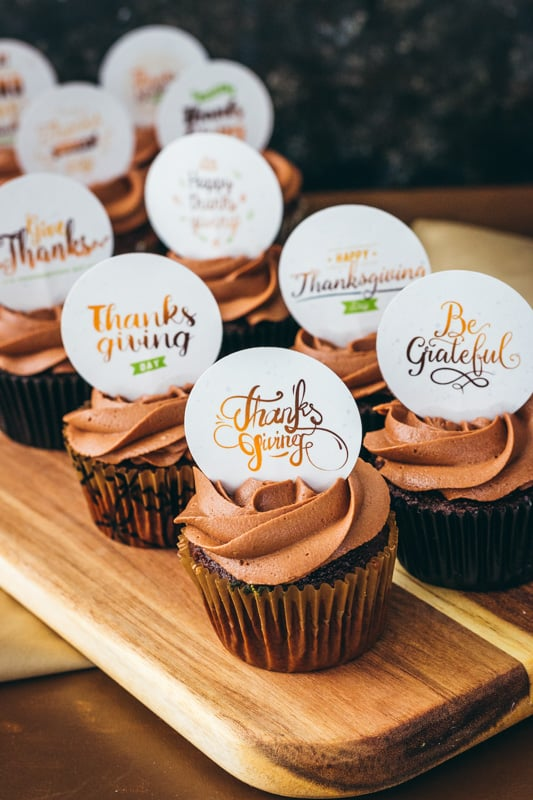 printable thanksgiving cupcake toppers on a wooden server