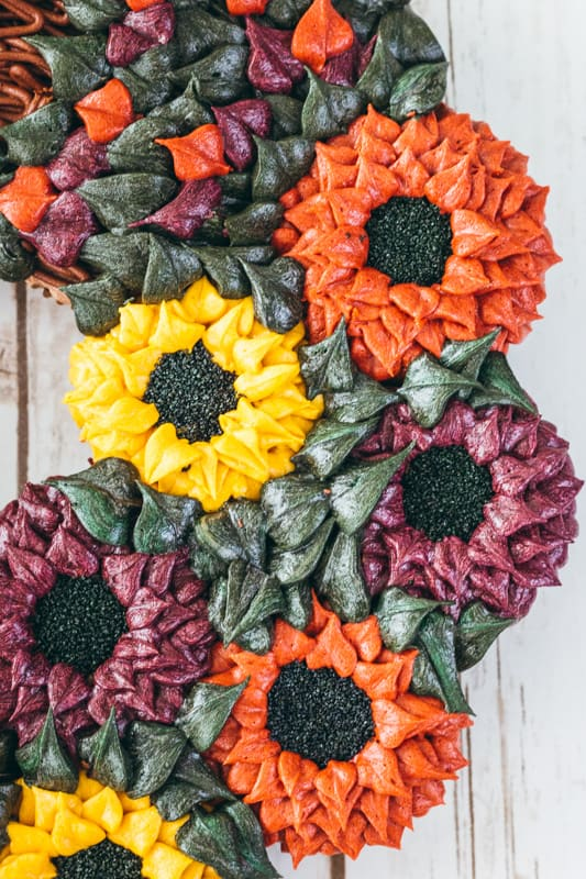 close up view of thanksgiving floral wreath cake