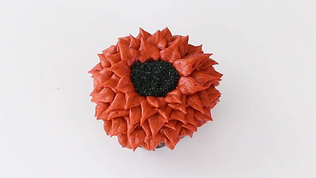 orange buttercream fall flower cupcake