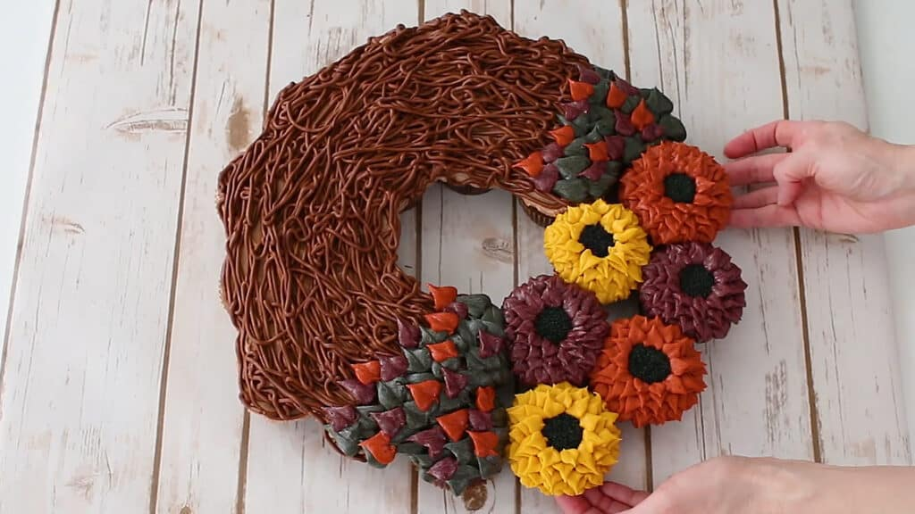 add flower cupcakes back into the wreath form