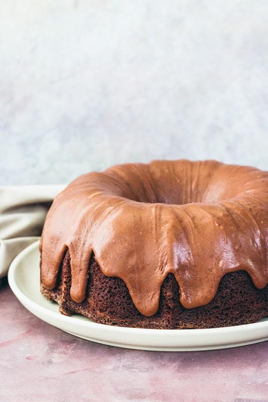 chocolate spice bundt cake on a cake plate