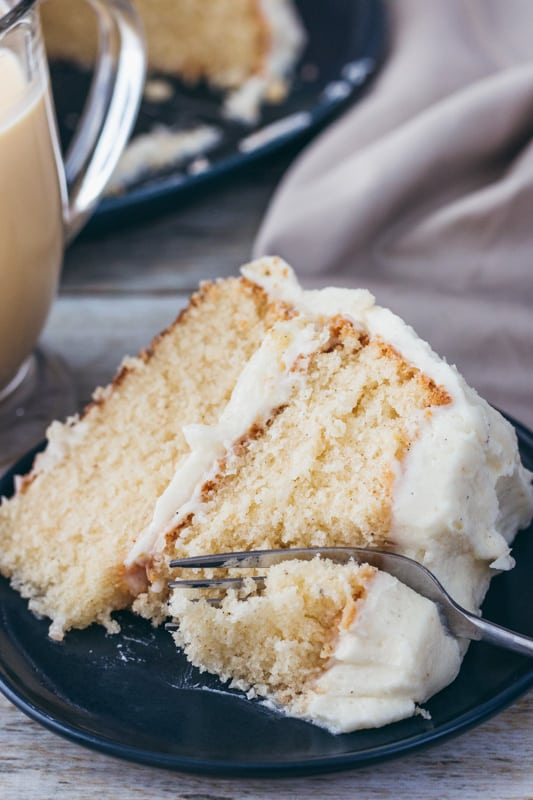 slice of spiced eggnog cake with a fork