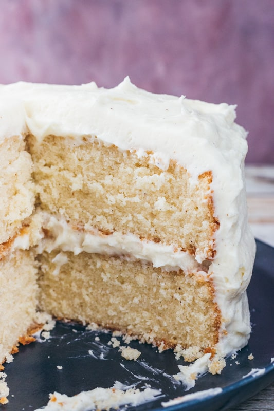spiced eggnog cake with a slice cut out