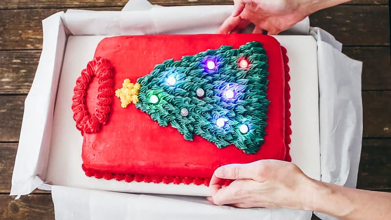 add the sweater cake to the gift box
