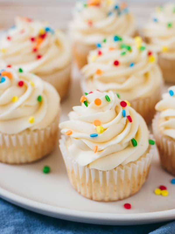 cake batter buttercream on cupcakes in a white platter