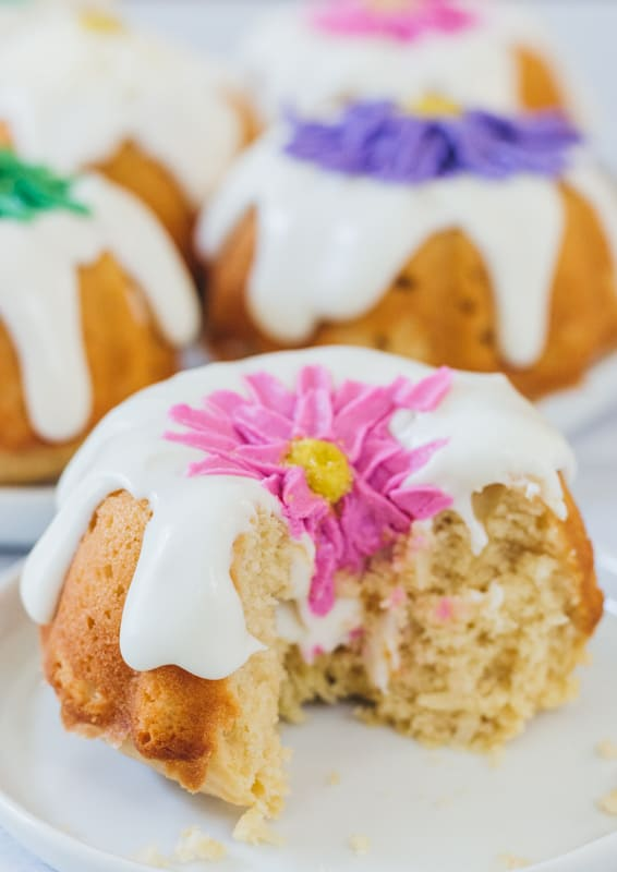 cut slice of mini bundt cake with buttercream flower