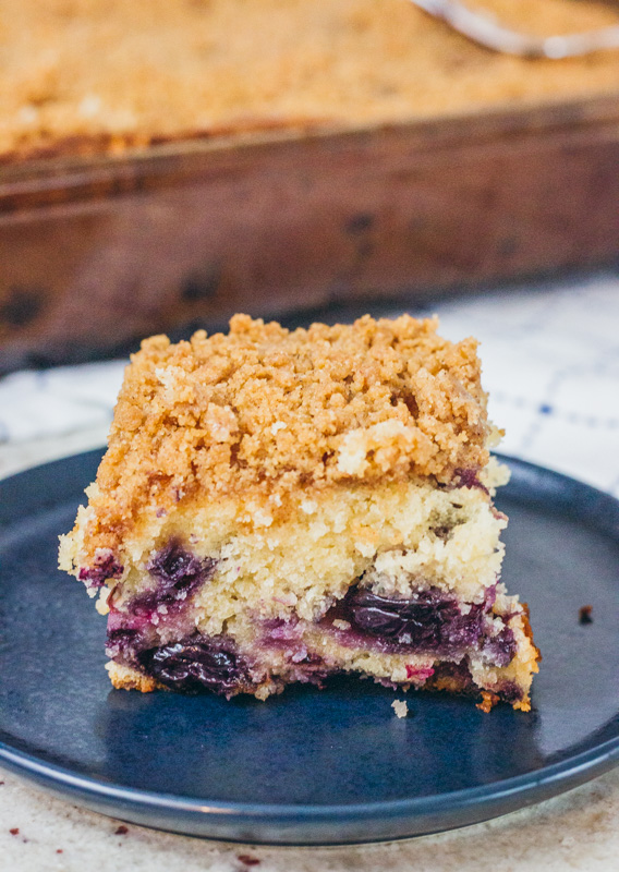 blueberry coffee cake slice on a blue plate