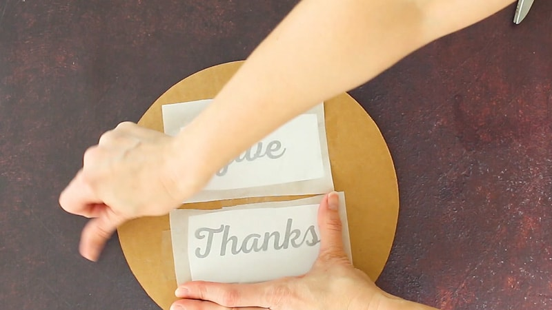 taping word templates to cake board