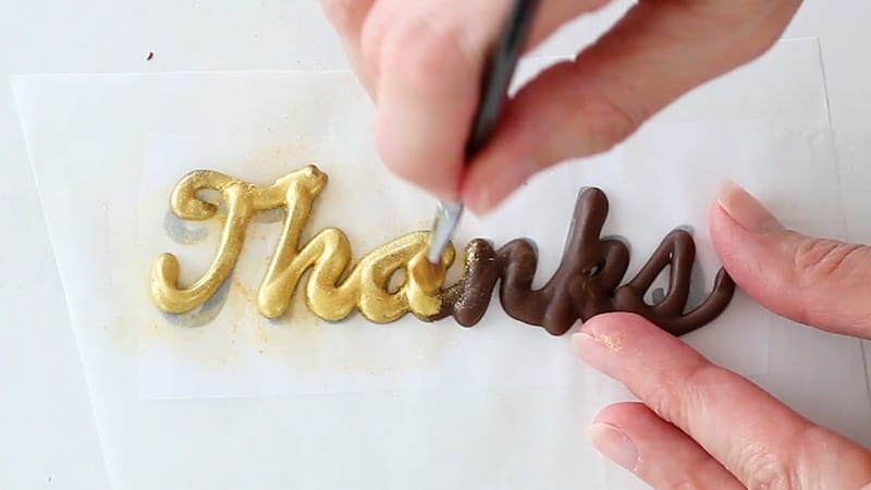 add luster dust to chocolate words